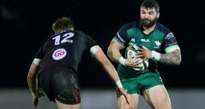 Sammy Arnold of Connacht runs at Ulster's Stewart Moore during the Guinness Pro 14 game at the Sportsground. Photograph: James Crombie/Inpho