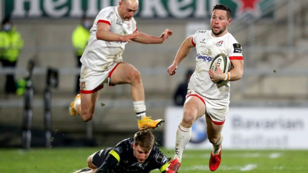 Ulster scrumhalf John Cooney makes a break during the Guinness Pro 14 game against Munster at the Kingspan stadium in Belfast. Photograph: Bryan Keane/Inpho