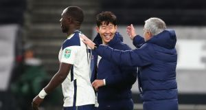 Moussa Sissoko and Son Heung-Min celebrate with Tottenham manager José Mourinho after they beat Brentford to reach the Carabao Cup final. Photo: Clive Rose/EPA