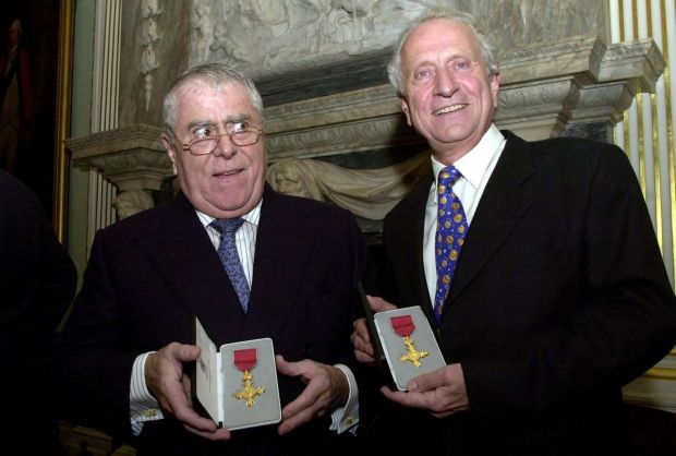 Albert (left) and Michel Roux awarded honourary OBE's by the British foreign secretary Jack Straw on behalf of Queen Elizabeth in central in 2002. Photograph: Johnny Green/PA Wire