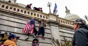 Protestors climb the Capitol building in Washington on Wednesday. Photograph: Jason Andrew/ New York Times