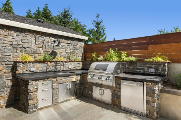 The trend for enhancing the area around our homes will continue in 2021, with demand predicted for outdoor kitchens. Photograph: Getty Images/iStockphoto