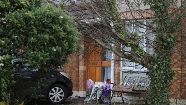 Floral tributes at the front door of the home of George Nkencho, Manorfields Drive, Dublin 15. Photograph: Nick Bradshaw
