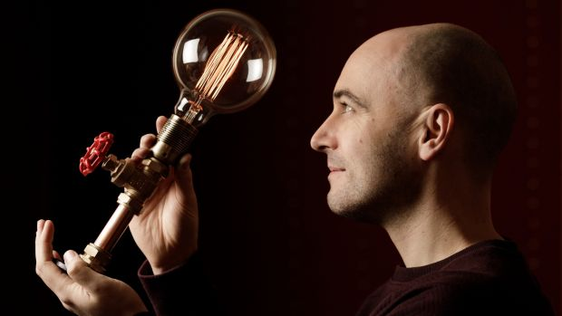 Kopper Kreation founder Emmet Bossonet with one of his copper light fittings