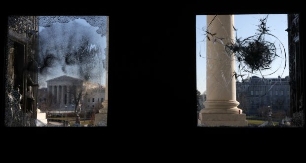 The US Supreme Court is seen through a damaged entrance of the US Capitol on Thursday. Photograph: Alex Wong/Getty Images