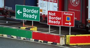 Signage indicates the direction vehicles should follow depending on the relevant paperwork for crossing to Ireland at the check-in area at Holyhead port in Anglesey, north Wales. Photograph: Paul Ellis / AFP