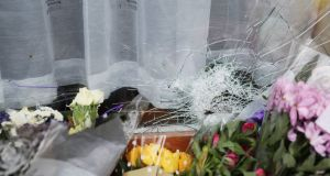 Flowers and a damaged window at the home of George Nkencho in Clonee, west Dublin, where he was shot multiple times by gardaí.  Photograph: Brian Lawless/PA Wire