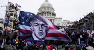 Pro-Trump protesters storm the grounds of the US Capitol, in Washington, DC. Photograph: Will Oliver/EPA