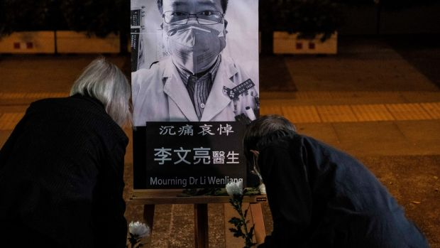 A vigil in Hong Kong on February 7th, 2020, for Dr Li Wenliang, the ophthalmologist at a Wuhan hospital who died from Covid-19. Li was reprimanded by the Chinese government for warning colleagues about the virus. Photograph: Lam Yik Fei/New York Times