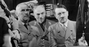 Reich interior minister Wilhelm Frick, far left, with Adolf Hitler. Photograph: Imagno/Getty