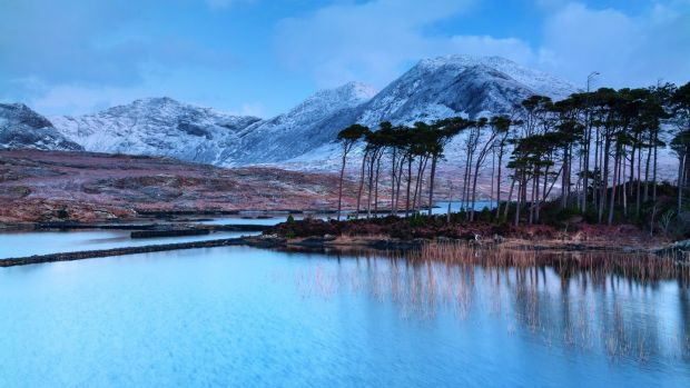 One of the oldest images in the book shows a wintry view of Derryclare Lough in Connemara. It was the first time I experienced snow in Ireland.