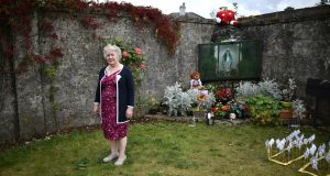 Tuam Mother and Baby Home survivor Carmel Larkin poses for a photograph as a vigil is held at the Tuam Mother and Baby home mass burial site on August 25th, 2019. Photograph: Charles McQuillan/Getty Images