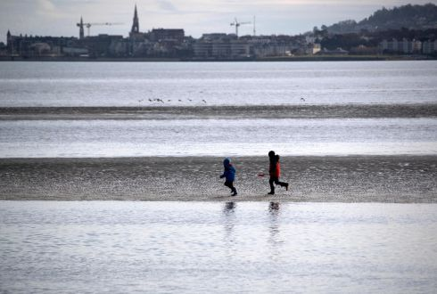 SAND AND SEA: Youngsters get the benefit of exercise on Sandymount Strand in Dublin in the afternoon. Photograph: Colin Keegan/Collins Dublin