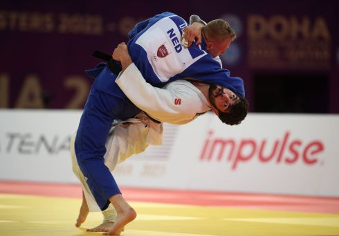 GETTING TO GRIPS: Georgia's Tato Grigalashvili (in white) and the Netherlands' Frank De Wit grapple with each other during the men's under 81kg category of the World Judo Masters championship, in the Qatari capital, Doha. Photograph: Karim Jaafar/AFP/Getty