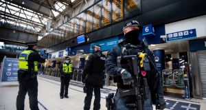 Armed police officers at Waterloo Station during the morning rush hour in London, as England's third national lockdown to curb spread of coronavirus continues. Photograph: Victoria Jones/PA Wire