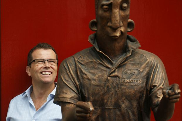 Paul Howard stands next to a statue of Ross O'Carroll-Kelly in Dublin. Photograph Nick Bradshaw