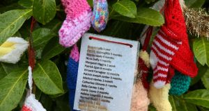 The name of babies and wollens hang in the rain in the Tuam babies burial ground on Tuesday. Photograph: Joe O'Shaughnessy