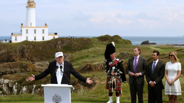 Donald Trump at his revamped Trump Turnberry golf course in South Ayrshire watched by his wife Ivanka and sons Donald Jr and Eric. Photograph: Andrew Milligan/PA Wire