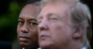 Tiger Woods listens while US president Donald Trump speaks during a presidential medal of freedom ceremony in the Rose Garden in  May, 2019. Photograph:  Brendan Smialowski/AFP via Getty Images