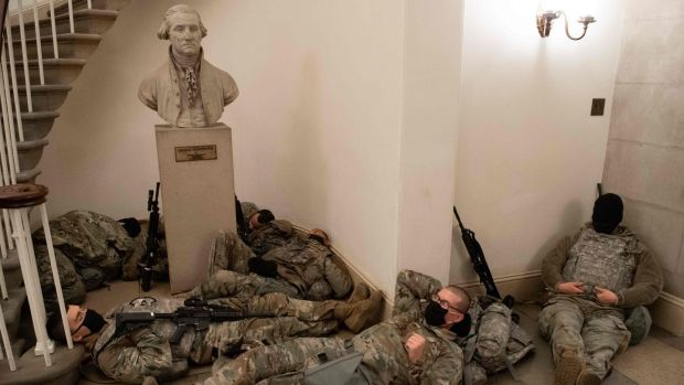 Members of the national guard take a rest in the Rotunda of the US Capitol in Washington on Wednesday. Photograph: Saul Loeb/AFP via Getty Images