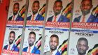 Election posters for presidential candidate Robert Kyagulanyi Ssentamu otherwise known as Bobi Wine adorn a locked store front in the capital Kampala. Photograph: EPA/STR