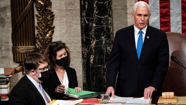 Mike Pence presides over a joint session of Congress to certify the 2020 electoral college results after supporters of President Donald Trump stormed the US Capitol earlier in the day. Photograph: Erin Schaff/POOL/AFP via Getty Images