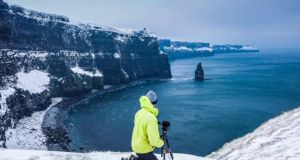 Cliffs of Moher: Kev L Smith takes a photograph in the snow on March 3rd, 2018