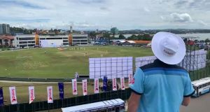 A solitary fan, Rob Lewis, watches the opening day action in Galle. Photograph: Rob Lewis/PA