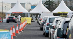 Cars  line up at the RocDoc rapid Covid test centre based  at Dublin Airport on Friday. Photograph: Alan Betson / The Irish Times