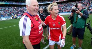 Cork manager Eamonn Ryan and Valerie Mulcahy celebrate at the end of the game after winning the 2015 All-Ireland. Photo: Ryan Byrne/Inpho