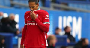 Liverpool   defender Virgil van Dijk's absence is causing his side to crumble. Photograph:   Catherine Ivill/POOL/AFP via Getty Images