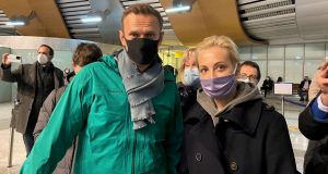 A handout picture posted by Kira Yarmysh, press secretary of Alexei Navalny, on Twitter shows the anti-corruption activist  and his wife Yulia  before passing the border control at the Sheremetyevo airport in Moscow, Russia, on Sunday. Photograph: EPA