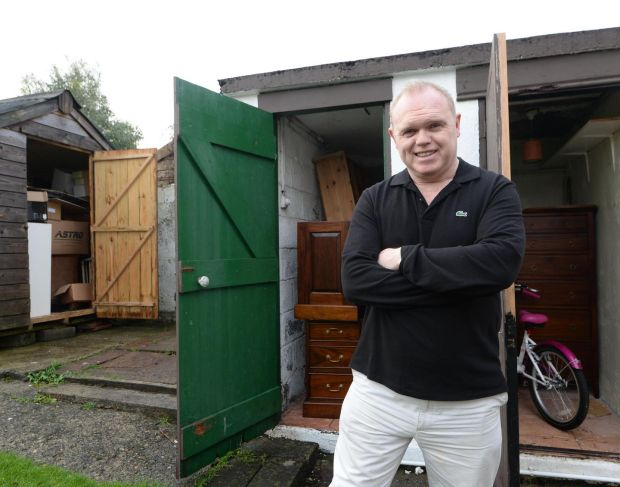Decluttering: Jason O'Callaghan outside a shedful of belongings he and his family dumped. Photograph: Alan Betson
