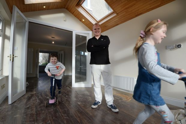Moving home: Jason O'Callaghan with his six-year-old son, Ethan, and eight-year-old daughter, Camille. Photograph: Alan Betson