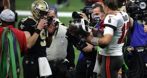Drew Brees of the New Orleans Saints talks with Tom Brady of the Tampa Bay Buccaneers after their NFC Divisional Playoff game. Photograph: Getty Images