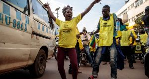 Supporters of the National Resistance Movement celebrate the victory of president Yoweri Museveni in Kampala, Uganda. Photograph:  Badru Katumba/AFP via Getty