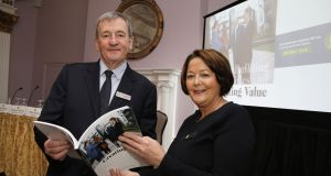 Ires Reit group chairman Declan Moylan and chief executive Margaret Sweeney pictured with its annual report at the group's 2019 agm. Photograph: Nick Bradshaw