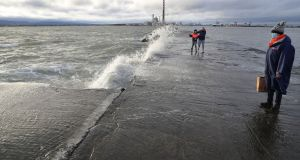 MAKE A SPLASH: Waves are seen on Dublin's South Bull Wall. Photograph: Nick Bradshaw/The Irish Times