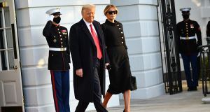 US president Donald Trump and first lady Melania make their way to board Marine One before departing from the South Lawn of the White House on Wednesday. Photograph:  Mandel Ngan/AFP via Getty