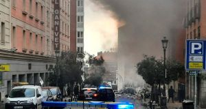Smoke rises from a building and rubble scattered in Toledo Street following a explosion in downtown Madrid, Spain on Wednesday. Photograph: Europa Press via AP