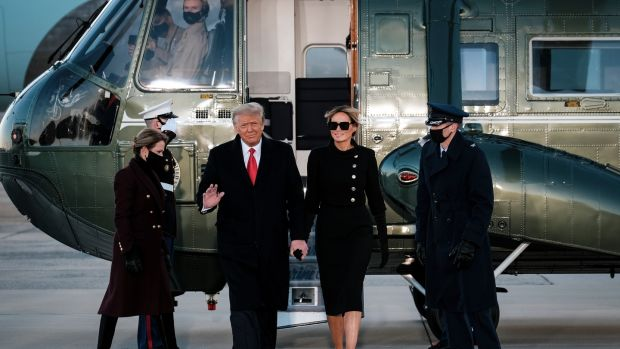 Donald and Melania Trump are heading to Air Force One for the last time.  Photograph: Pete Marovich / The New York Times