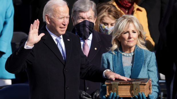 Joe Biden is sworn in as President of the United States as his wife Dr. Jill Biden looks on.  Photograph: Alex Wong / Getty Images