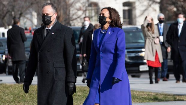 Vice President-elect Kamala Harris in Christopher John Rogers outfit and husband Douglas Emhoff in Ralph Lauren arrive at the United States Capitol.  Photograph: EPA / Rod Lamkey