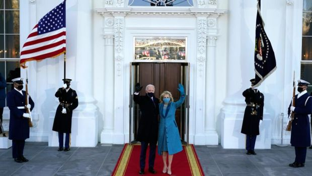 US president Joe Biden and first lady Dr Jill Biden wave as they arrive at the North Portico of the White House in Washington DC on Wednesday. Photograph: Alex Brandon/EPA/Pool