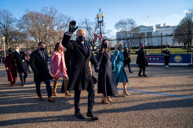 US president Joe Biden and first lady Dr Jill Biden walk along Pennsylvania Avenue with their family in front of the White House on Wednesday. Photograph: Doug Mills/EPA/Pool