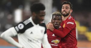 Manchester United's Paul Pogba celebrates scoring his team's second goal with Bruno Fernandes during the  Premier League win over Fulham at Craven Cottage. Photo: Peter Cziborra/POOL/AFP via Getty Images