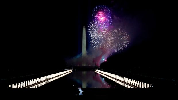 "Singer Katy Perry performs in front of a firework display during the ""Celebrating America"" event at the Lincoln Memorial. Photograph: Joshua Roberts/Pool/AFP via Getty Images"
