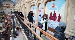 People  queue to get  Russia's Sputnik V coronavirus vaccine in a vaccination centre in the GUM State Department store in Moscow on Wednesday. Photograph: AP