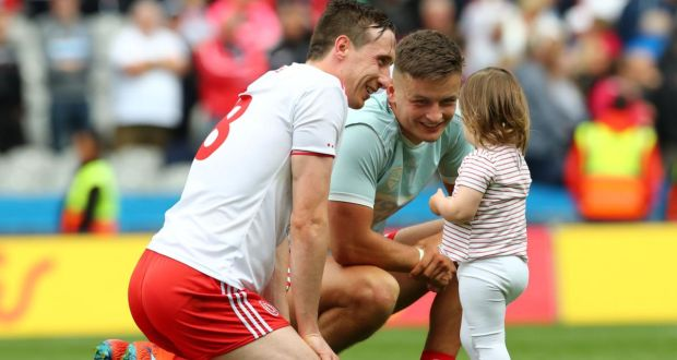 Tyrone's Colm Cavanagh and his daughter Chloe with Michael McKernan after the All-Ireland semi-final against Dublin in August 2019. Photograph: James Crombie/Inpho
