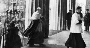 Archbishop of Dublin John Charles McQuaid arriving at the Pro Cathedral for the funeral of president Sean T O'Kelly in 1966. Photograph: Tommy Collins